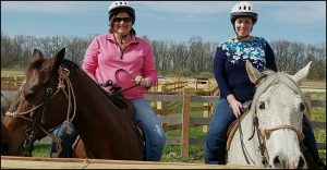 Sara and Lisa on horses